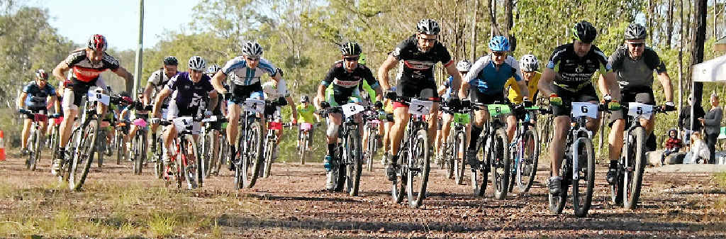 RACE IS ON: Riders set off in round three of Mountain Biking Bundaberg's XCO series on Sunday, where Gladstone's Michael England (inset) went to to win the expert men's division.