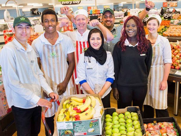 NEW RECRUITS: Orara students Farhad Safizadeh, Amanuel Ayelew, Achol Garang and Narges Safizadeh are now part of the Woolworths team. Photo: Trevor Veale