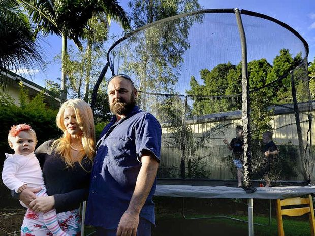THREATENED: John de Graaf, his partner Sade Ellis with children Jade, Blair and Dante were trapped in their home by their neighbours' dogs.