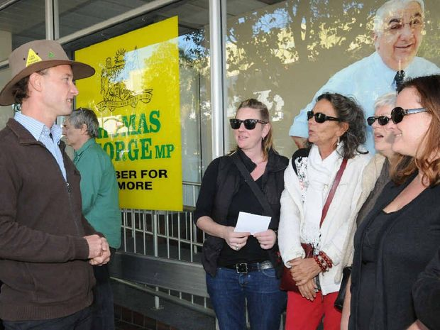 SPEAKING OUT: Adams Guise, Greens candidate for Lismore addressing protesters outside Thomas George MP's office.