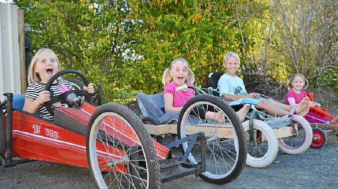 READY TO SCREAM: The Oosterbeek siblings Lilly, Abby, Noah and Daisy test out their vehicles for the Kyogle Billycart Bonanza on Father's Day.