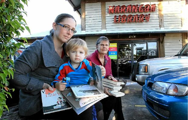 KEEPING CONNECTED: Melina Dahms, with son Christian, and Janice Ridley are upset at the closure of Narangba Library.