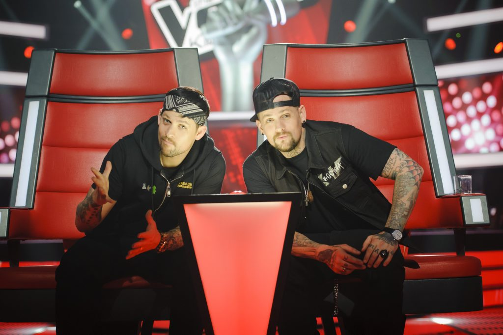Joel, left, and Benji Madden in their custom chair on The Voice Kids.