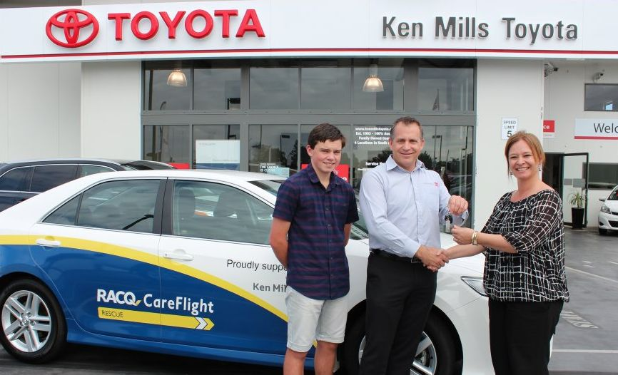 GRATEFUL GIFT: Tyler Favier and Brett Mills thank RACQ CareFlight with the gift of a car. Photo Contributed: RACQ CareFlight