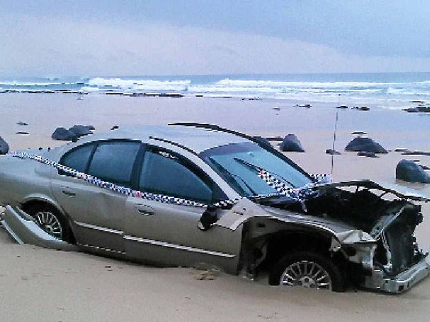 MAJOR MISHAP: A car on the beach at the bottom of the Lighthouse Beach lookout.