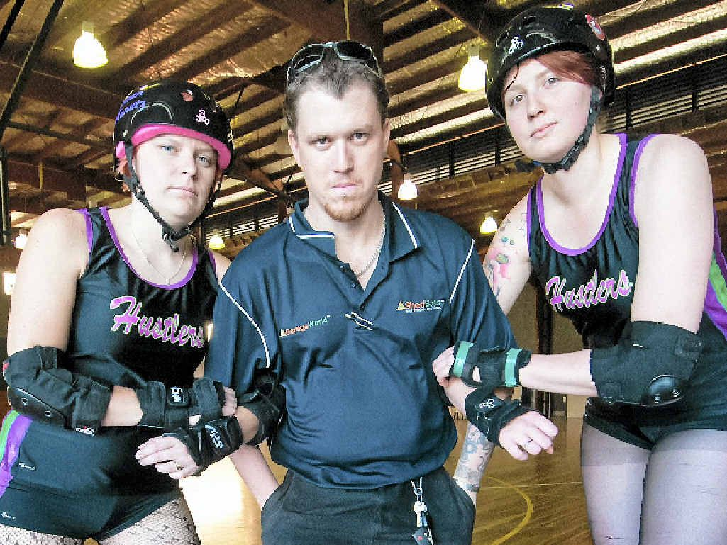 ON A ROLL: Hustlers' roller derby coach Charlie Keenan (centre) would love to see a dedicated roller derby track, as well as more activities for kids, if he was mayor.