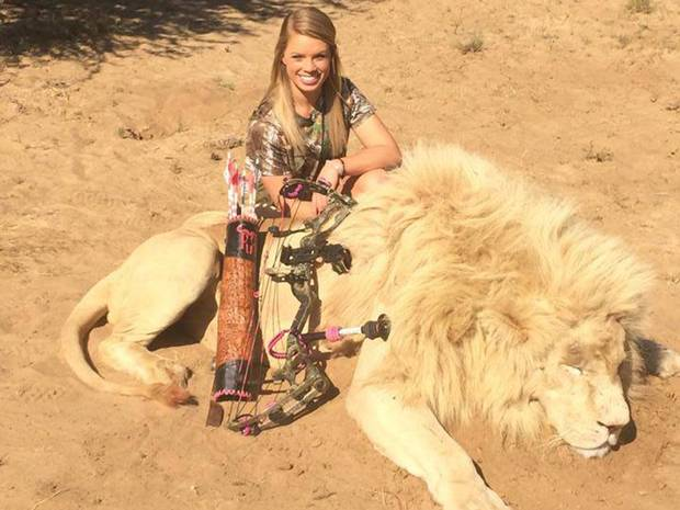 Kendall Jones, posing with a lion she hunted, is now the subject of two separate petitions
