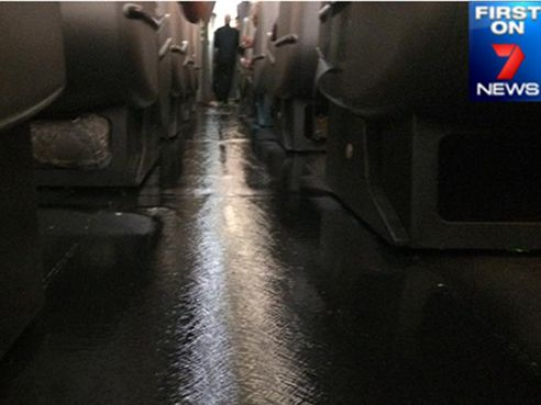 A photo from within the plane showing the water leak on the Qantas flight. Photo: Seven News / Twitter
