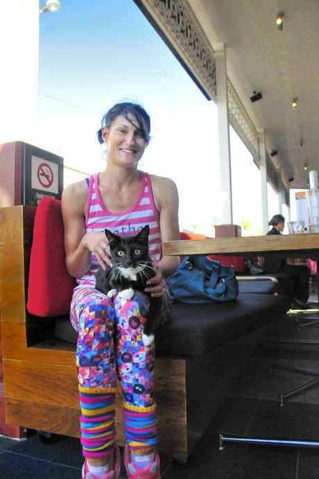 SURPRISE: Jactinta Hinton with the cat she rescued after it jumped from a moving car on Goondoon St.