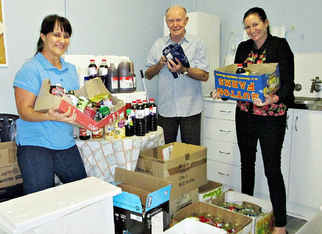 SAVED: Anglicare's Esde Madden (left), regional director John Langford and counsellor Katrina Dunn with about $3000 worth of food donated anonymously.