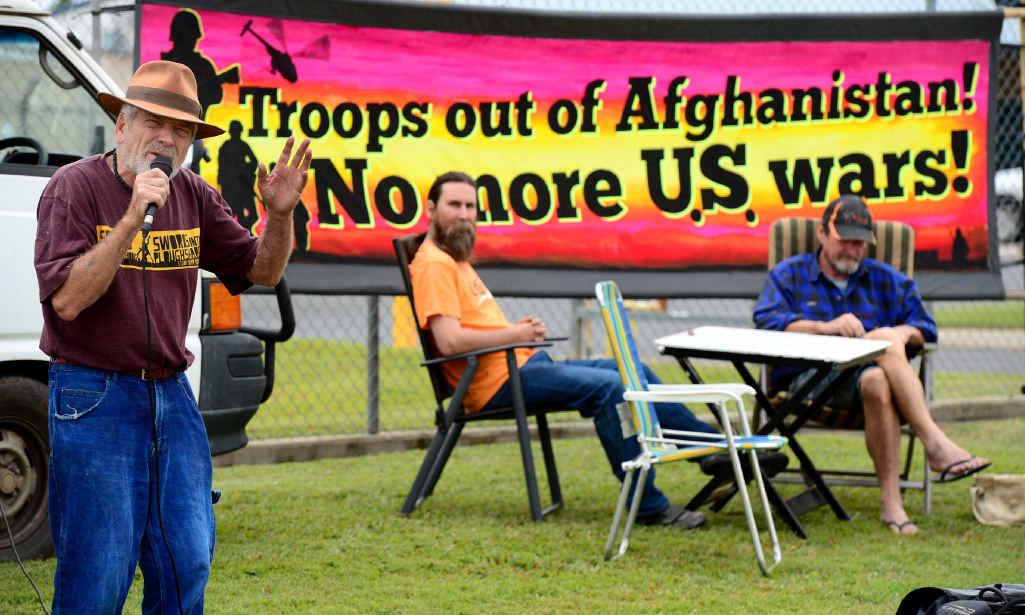 HEAR THIS: Peace activist Graeme Dunstan delivers his message during a public speakout outside the army barracks in Rockhampton.