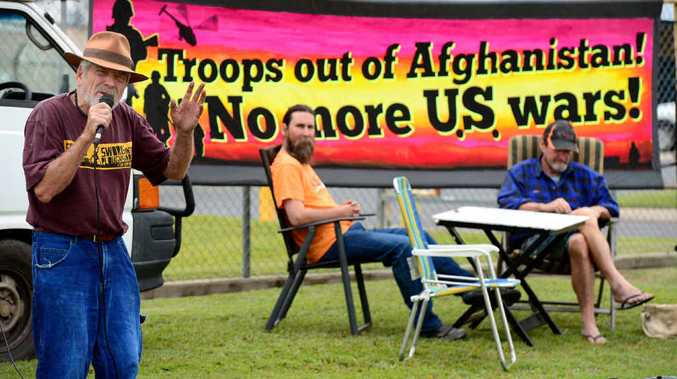 HEAR THIS: Peace activist Graeme Dunstan delivers his message during a public speakout outside the army barracks in Rockhampton.