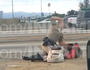 Video appears to show officer punching woman on the floor