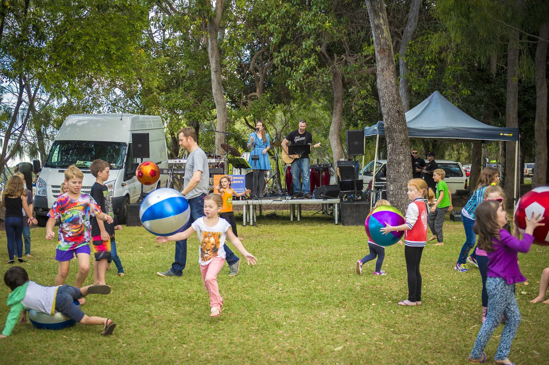 Children enjoying the music and festivities at the Beach Arts Music festival at Tannum Sands.