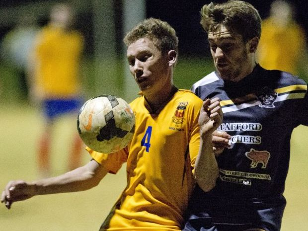 CONTEST: USQ's Jed Sugden and West Wanderers' Jarrad Mason battle for the ball during their Football Toowoomba Premier Men's match.