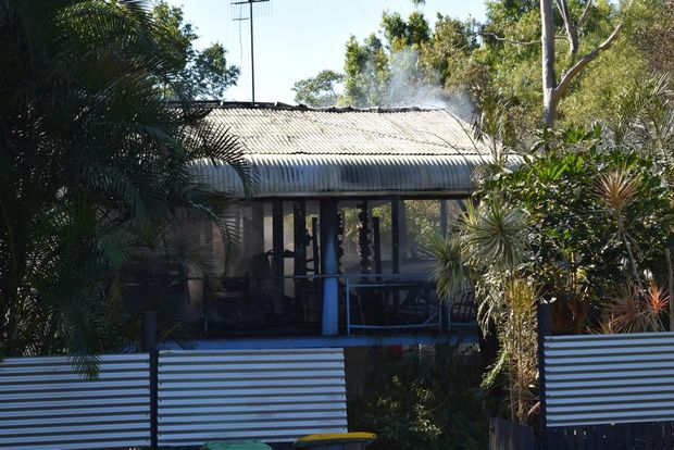 Four firefighter crews work to extinguish a blaze at Toolga St, Mount Coolum. The fire was believed to have started a candle catching alight a curtain in a bedroom. Photo Megan Mackander / Sunshine Coast Daily
