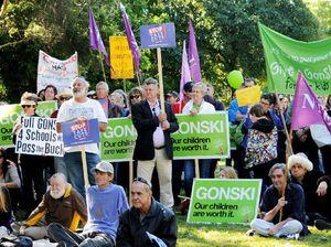 Community rallies against budget plans