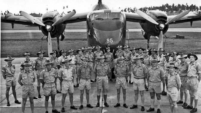 WALLABY AIRLINES: Members of RAAF No. 35 Squadron on parade with a Caribou aircraft in Jluy 1964.