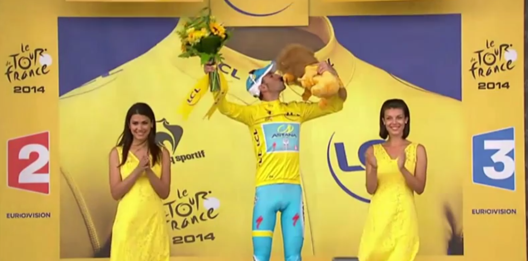 Tour de France stage two winner Vincenzo Nibali settles for kissing a plush lion after a podium woman declined his polite kiss