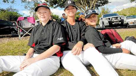 GOOD TIMES: Jessica Sullivan, Karen Gallpen and Darian Lawton, from Brisbane team The Baddies, take some time out during the Timberjacks carnival at Albert Park, Lismore.