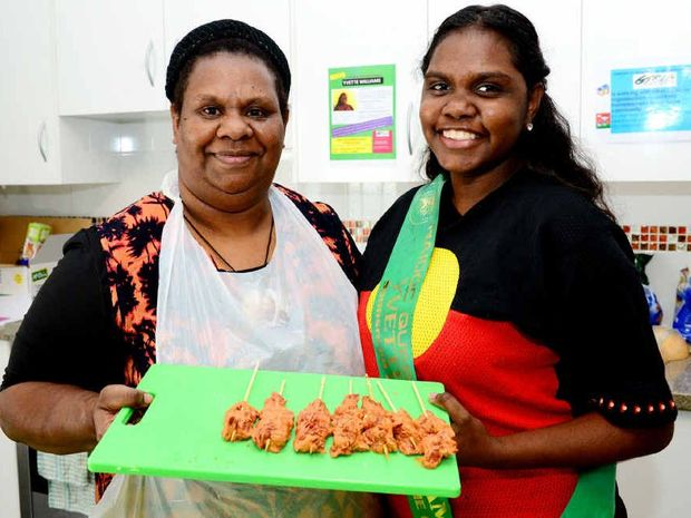 SHARING THE LAUGHTER: Rockhampton's Janette Moulder and NAIDOC quest entrant Yvette Williams show a sample of the Indigenous food they cooked at a MasterChef class at Girls Time Out.