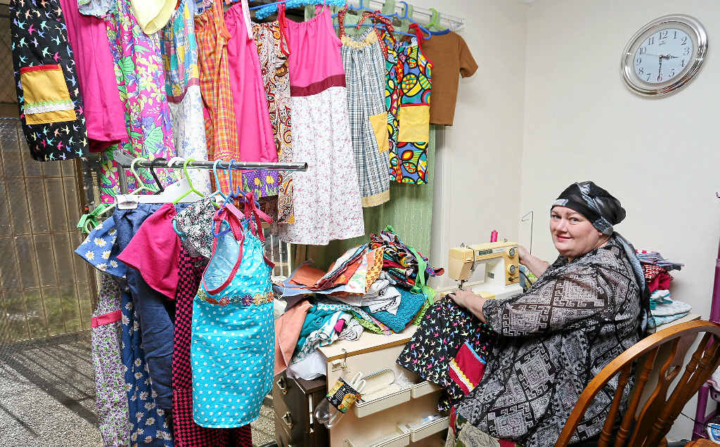 HAPPY TO HELP: Eliza Leahy is sewing hundreds of dresses to send to children in poor countries.