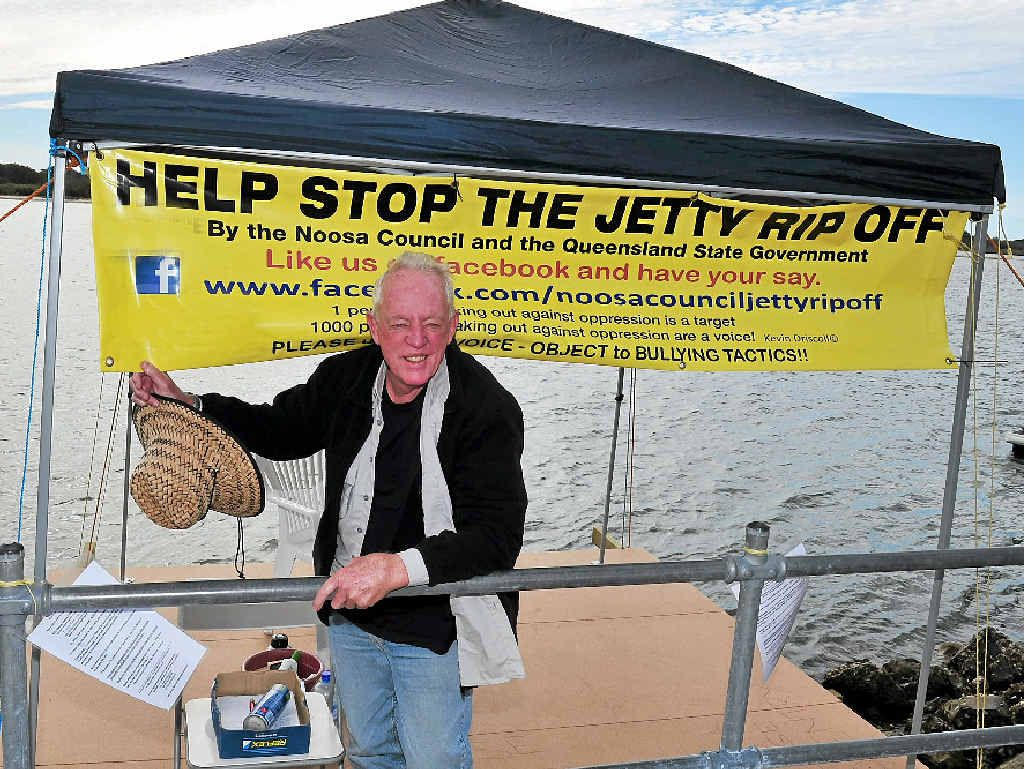 LOCKED INTO BATTLE: Kevin Driscoll protests at his Noosa River jetty site near William St.