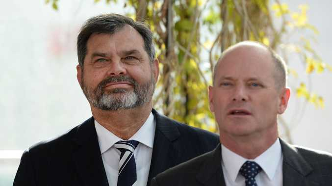 Queensland Chief Justice Tim Carmody (left), looks on as former Premier Campbell Newman speaks during the announcement at the Supreme Court in Brisbane. Mr Carmody's appointment to replace outgoing Supreme Court Chief Justice Paul de Jersey is now under pressure.