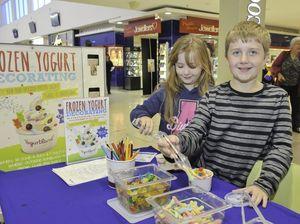 Kids swamp Yogurtland stall to make tasty treats