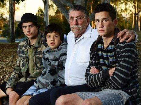 House fire victims Graeme Tudor with his step-son Mark Whelan (left) and two sons Owen (centre) and Edward Tudor. Photo: David Nielsen / The Queensland Times
