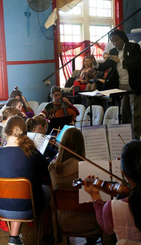 RAISING THE BAR: Bogota Philharmonic Orchestra conductor Luis Fernando Madrid Ospino prepares the Northern Rivers Youth Orchestra and 11 of their Sydney counterparts at the Northern Rivers Conservatorium for Thursday's concert.