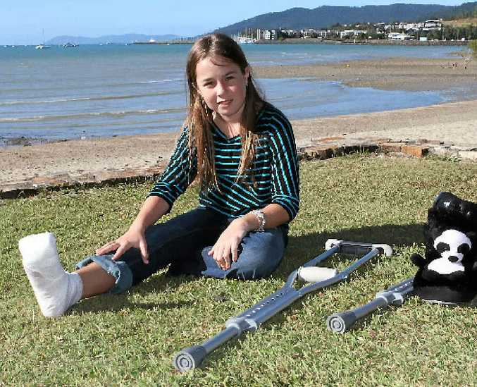 Hayley Allen, 11, is facing weeks of hospital visits after being bitten by a toadfish in Whitsunday waters.
