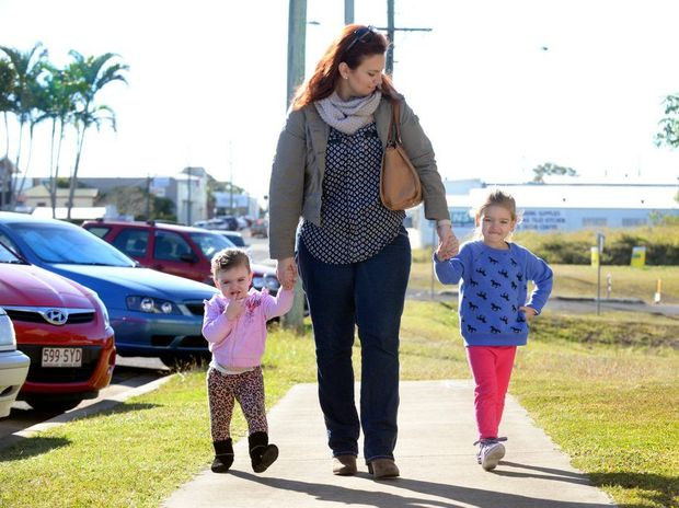 FAMILY BUDGET: Bella and Abby Vine walking with their mother Jess Vine who is concerned about the Federal Government's proposed GP co-payment and the impact on her family budget. Photo: Zach Hogg / NewsMail