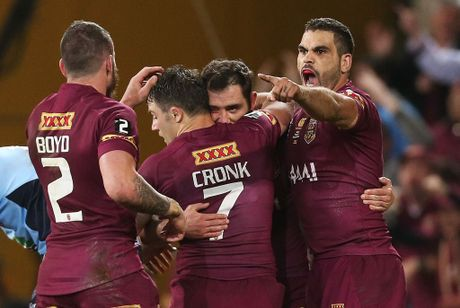 Cameron Smith of the Maroons celebrates scoring a try with team mates Greg Inglis, Cooper Cronk and Darius Boyd during game three of the State of Origin series between the Queensland Maroons and the New South Wales Blues at Suncorp Stadium on July 9, 2014 in Brisbane, Australia. (Photo by Mark Metcalfe/Getty Images)