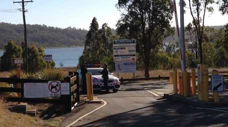 Police have cordoned off the recreation area at Cooby Dam.