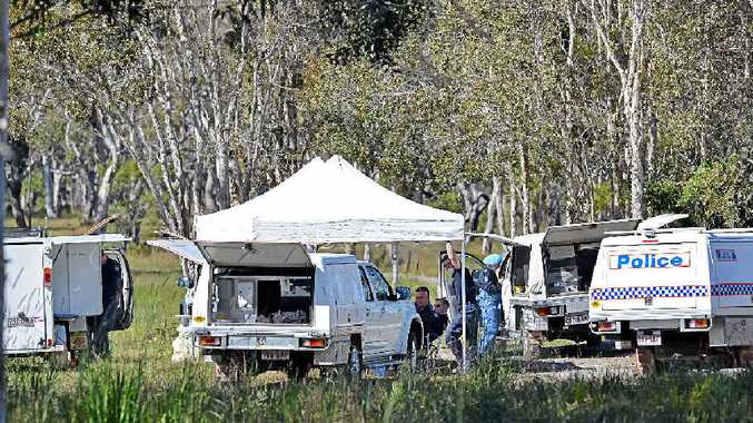 SEARCH FOR CLUES: A Cooloola Cove residence has been the subject of a police forensic investigation this week with a possible connection to the suspicious death of a Gold Coast man, whose skull was found in Toolara Forest earlier this year. Police are pictured above on the property Tuesday. The search has ended but investigations continue.