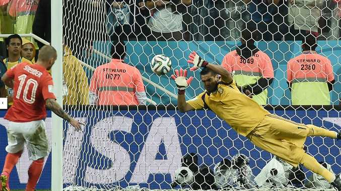 Argentina's Sergio Romero saves Wesley Sneijder's penalty, knocking out the Netherlands and ushering Argentina into the World Cup final against Germany.