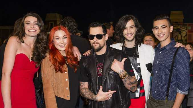 The Voice coach Joel Madden, centre, pictured with his singers, from left, Holly Tapp, eliminated Taila Gouge, Frank Lakoudis and Isaac McGovern. Supplied by Channel 9/WIN.