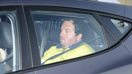 Geoffrey Joseph Sleba is taken into police custody yesterday over the alleged hit-and-run death of Dr Martin Pearson.