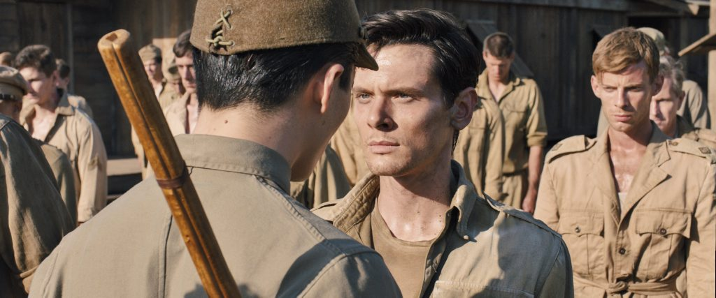 Jack O'Connell and Takamasa Ishihara in Unbroken.