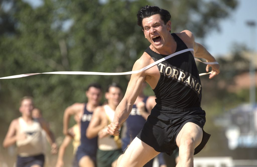 Jack O'Connell as a young Louis Zamperini in Unbroken.