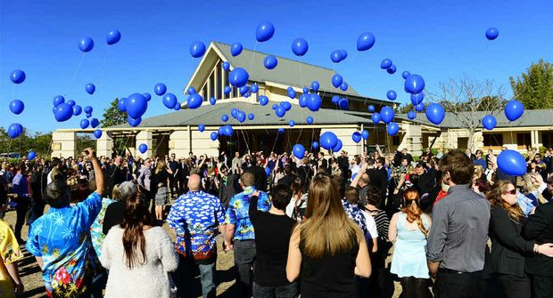FINAL FAREWELL: Blue balloons were released following the funeral service of Tom Bond held at Centenary Memorial Gardens.
