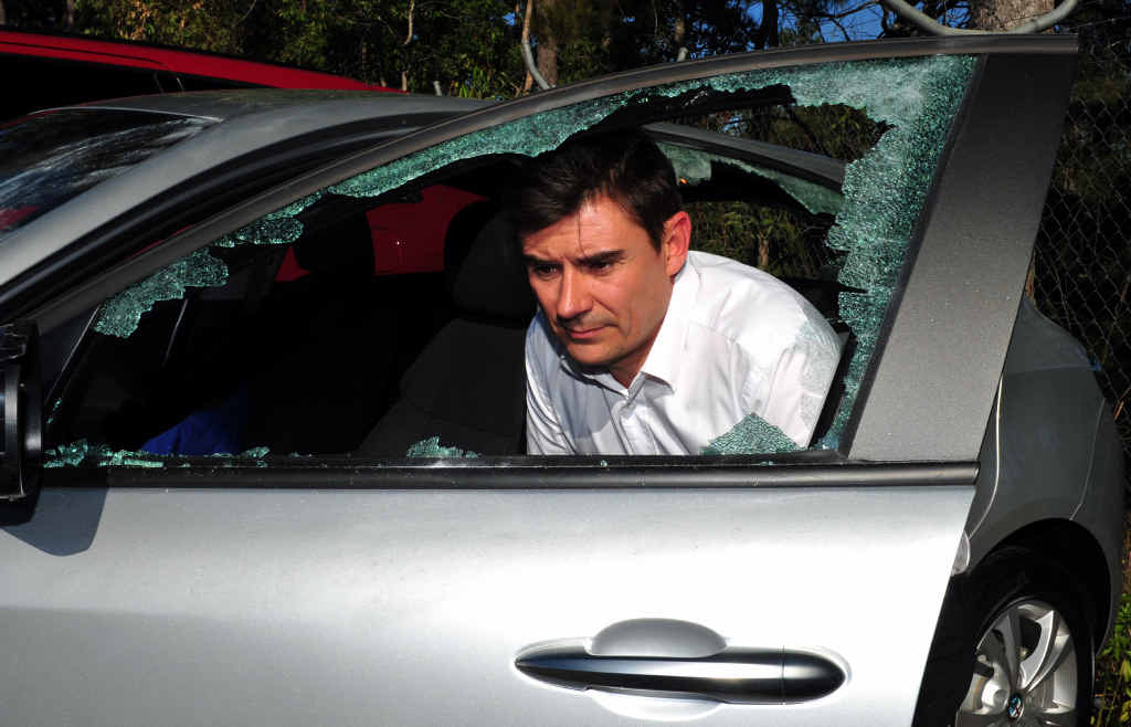 SMASHED: Crick Auto Group Noosa general manager Gary Ogilvy checks out some of the senseless vandalism carried out at his car yard.
