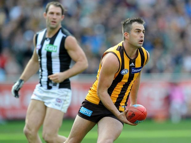 Brian Lake of Hawthorn runs with the ball, during the Round 14 AFL match between the Hawthorn Hawks and the Collingwood Magpies at the MCG in Melbourne, Saturday, June 21, 2014.