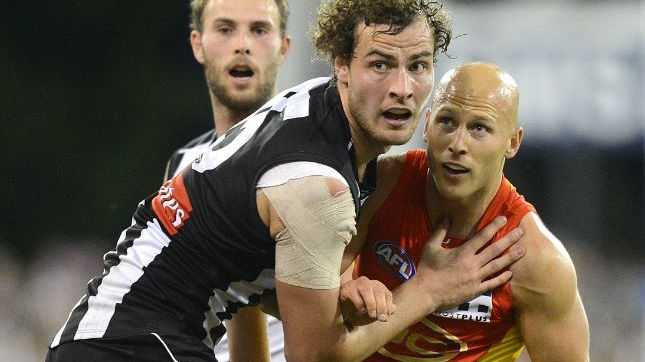 Magpies player Jarrod Witts (left) competes with Suns player Gary Ablett during the Round 16 AFL match between the Gold Coast Suns and the Collingwood Magpies at Metricon Stadium on the Gold Coast, Saturday, July 5, 2014.