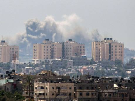 Smoke billows from buildings following an Israeli air strike in Gaza City