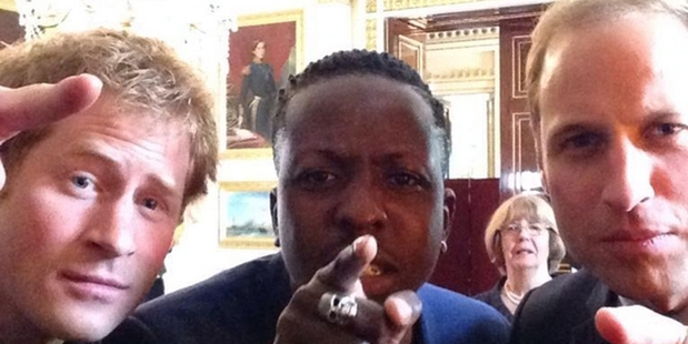 Harry, with Jamal Edwards and William (right) get involved with a Twitter Mirror at Buckingham Palace.