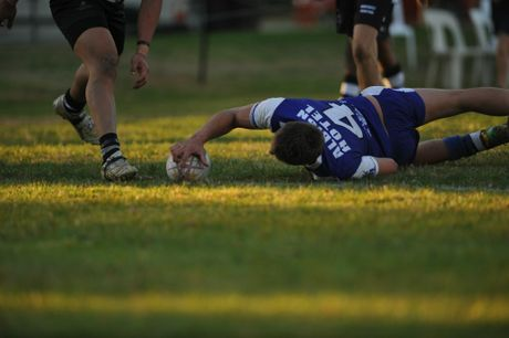Grafton Ghost Matt Muller steps through defence and reaches out to score a try in their Group 2 match against Bellingen Magpies at Frank McGuren Field. He finished with 40 points. Photo Matthew McInerney / Daily Examiner