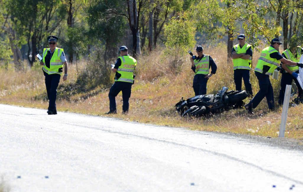 CRASH SCENE: Police at the scene of a fatal motorbike crash on Wivenhoe-Somerset Road, Bryden.