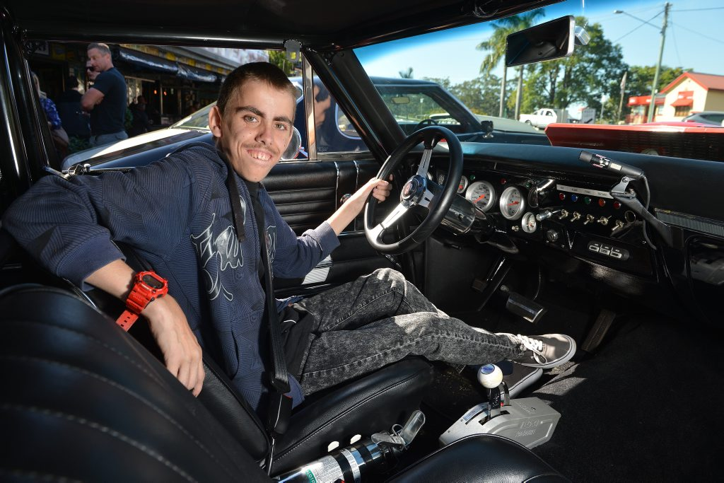 Joshua Miletic checks out a 1968 Chevelle owned by Scott Hipwell (Not in this photo). Photo: Warren Lynam / Sunshine Coast Daily